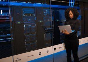 Technician standing analysing data centre